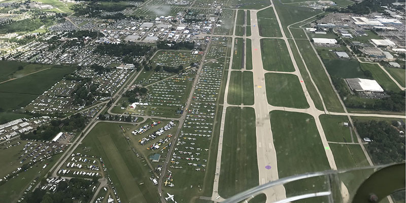 https://www.airshowtravel.co.nz/wp-content/uploads/aerial_oshkosh_2018_800_400.jpg